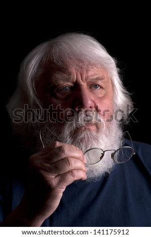 Old man, scientist and teacher with beard and glasses - stock photo