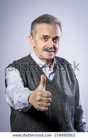Old man showing thumbs up - stock photo