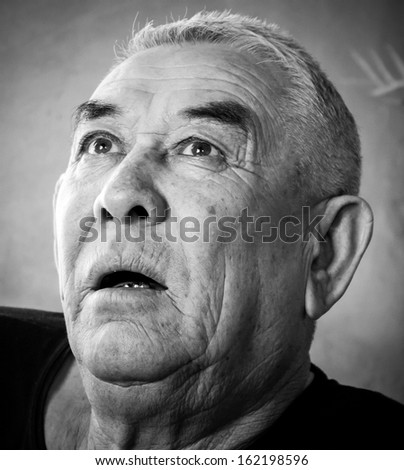 old man sitting and thinking - stock photo