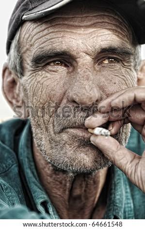 old man smoking - stock photo