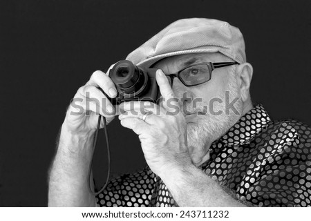 Old Man taking a Photograph with a Camera - stock photo