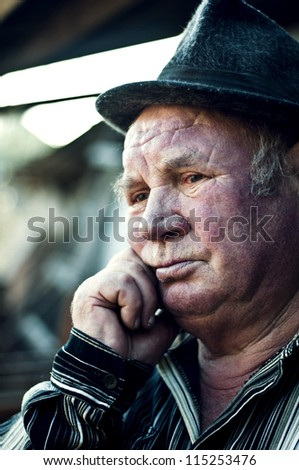 old man thinks about past - stock photo