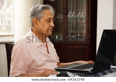 Old man using internet - stock photo