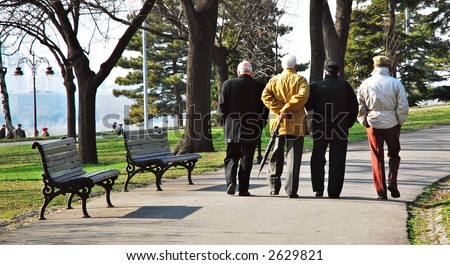 Old man walking in park - stock photo