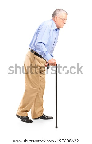 Old man walking with cane isolated on white background - stock photo