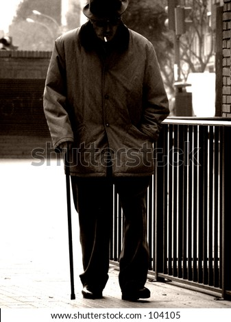 Old man walking with stick - stock photo