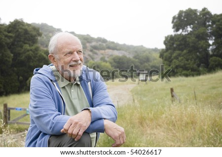 Old Man With a Beard Resting at the End of a Nature Trail - stock photo