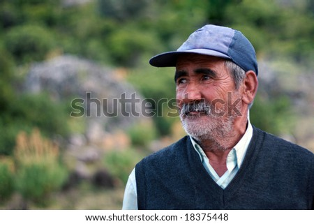 old man with a blue hat outdoors - stock photo