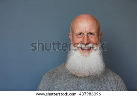 old man with a long beard with big smile on a blue background