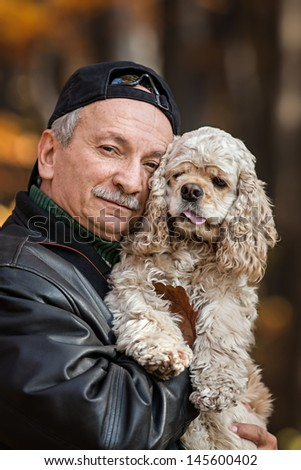 Old man with dog in the forest - stock photo