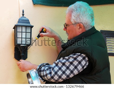 Old man with glasses posing for portrait - stock photo