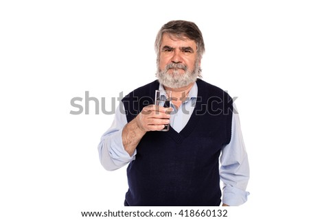 old man with gray beard having a glass of water in hand