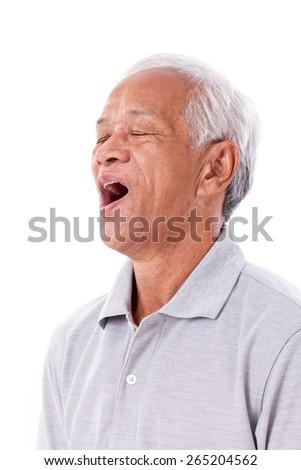 old man yawning - stock photo