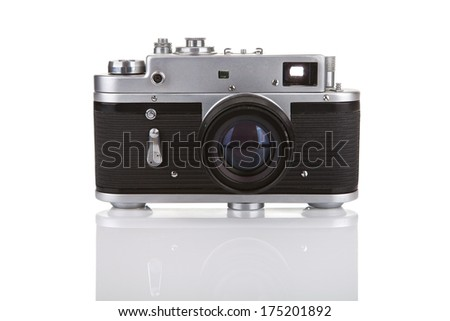 Old manual camera on white background with reflection - stock photo