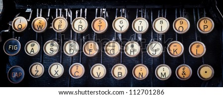 Old Manual Typewriter keys - dirty and faded keys on black cover. - stock photo