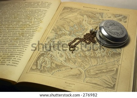 old map and watch - stock photo