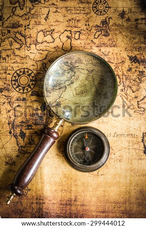old map with compass and Magnifier - stock photo