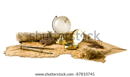 old maps, compass and globe on a white background - stock photo
