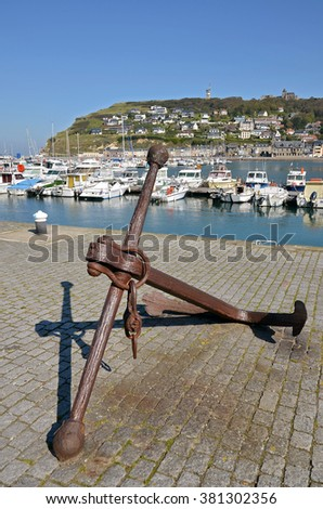 Old marine anchor in the port of Fecamp, commune in the Seine-Maritime department in the Haute-Normandie region in northwestern France - stock photo