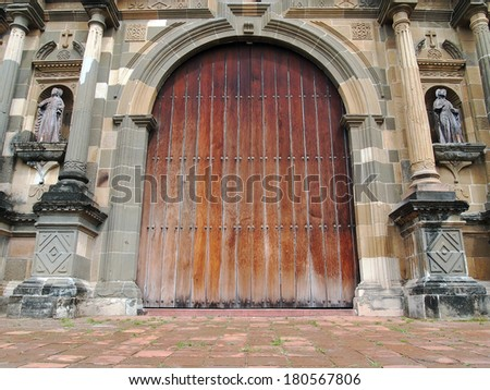 Old massive door of the Metropolitan Cathedral in Casco Viejo, Panama City, Panama - stock photo