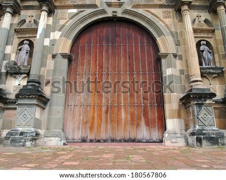 Old massive door of the Metropolitan Cathedral in Casco Viejo, Panama City, Panama - stock photo