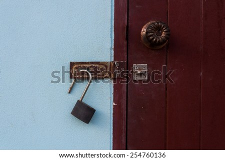 Old master key and the wood door. - stock photo