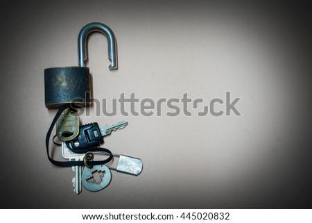 Old master key rusty and key lock on gray grunge background, key lock and master key - stock photo