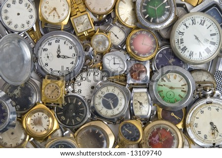 Old mechanical and electronic watch on a light background. - stock photo