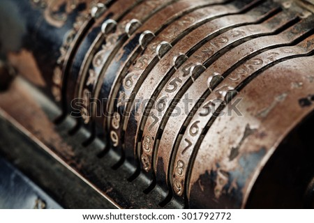 old mechanical manual counting machine for mathematical calculations - stock photo