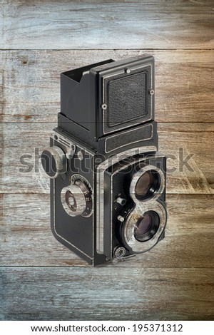 old Mediam format Camera in Wood background - stock photo