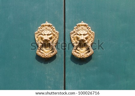 Old medieval bronze door knocker lion head - stock photo