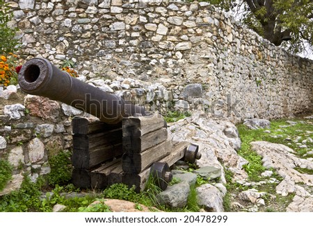 Old medieval era military gun situated inside a medieval castle - stock photo