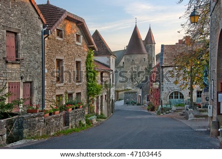 Old medieval looking european street - stock photo