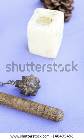 Old medieval mace, detail of an ancient weapon of war, and ancient object collection, war - stock photo