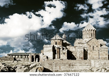 old medieval monastery against cloudy sky background - stock photo