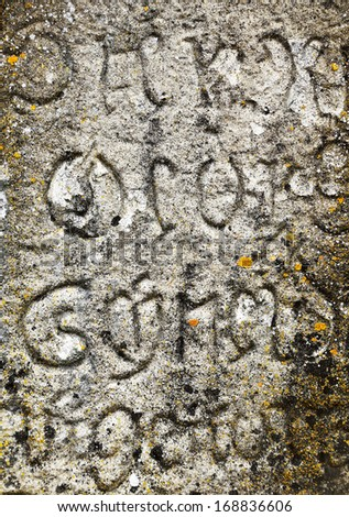 Old medieval stone writing