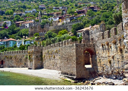 Old Mediterranean Town of Alanya Behind Fortress Wall Near the Sea, Turkey - stock photo