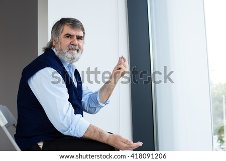 old men holding some pills in hands - stock photo