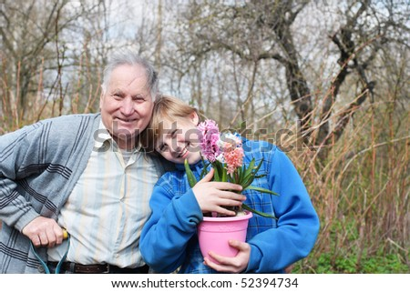 old men with boy in garden