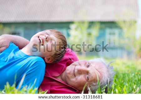 old men with boy outdoor - stock photo