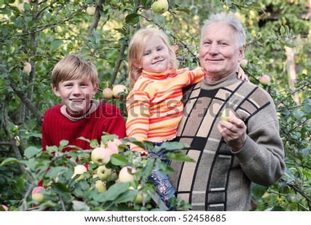 old men with children in garden - stock photo