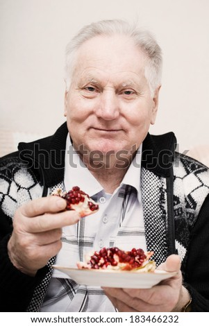 old men with pomegranate - stock photo