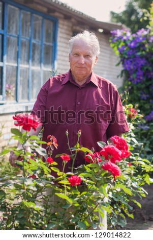 old men with rose in garden