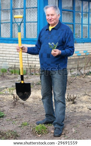 old men with spade - stock photo