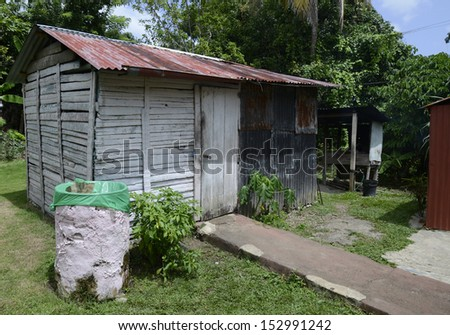 old metal and wooden shed found in the Dominican Republic in the jungle - stock photo