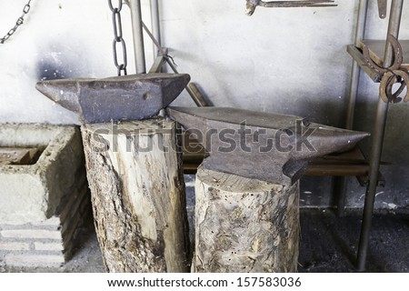 Old metal anvil, detail of an old blacksmith abandoned traditional metal work - stock photo