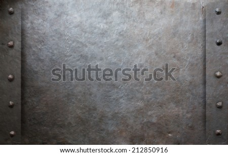 Old metal background with rivets - stock photo