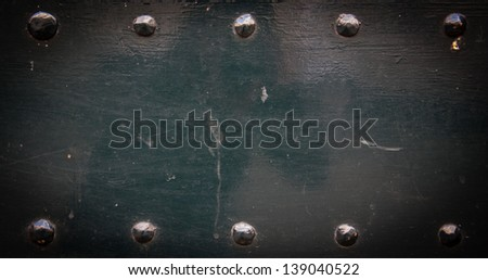 Old metal background with rivets. Vintage abstract texture with shading borders. - stock photo