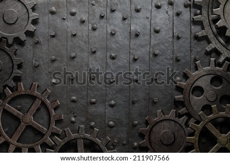 old metal background with rusty gears and cogs - stock photo