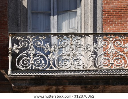Old metal balcony in village building - stock photo